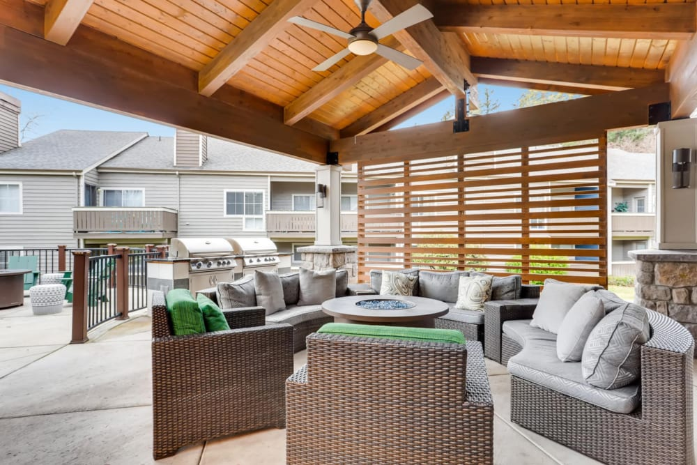 Covered lounge seating by the pool at The Carriages at Fairwood Downs in Renton, Washington