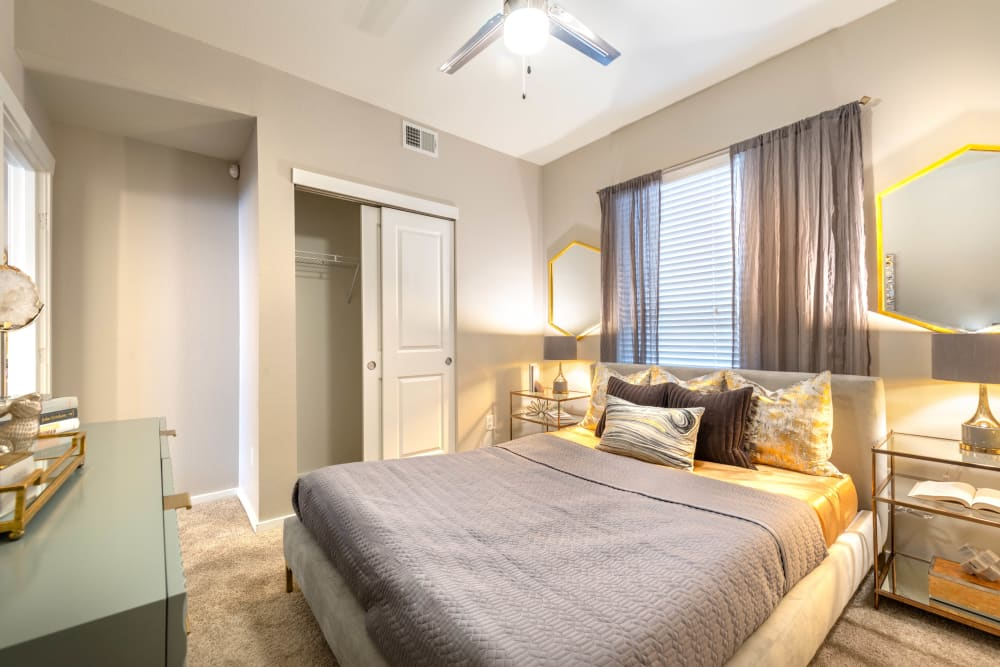 Well-furnished master bedroom in a model apartment at Olympus Solaire in Albuquerque, New Mexico