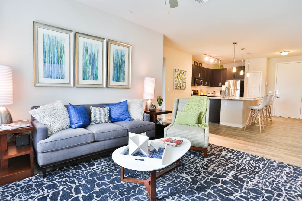 Bright and welcoming open-concept floor plan in a model apartment at Olympus Steelyard in Chandler, Arizona