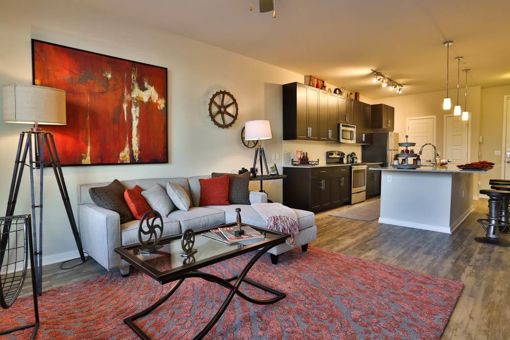 Hardwood floors throughout the living areas of a model home at Olympus Steelyard in Chandler, Arizona