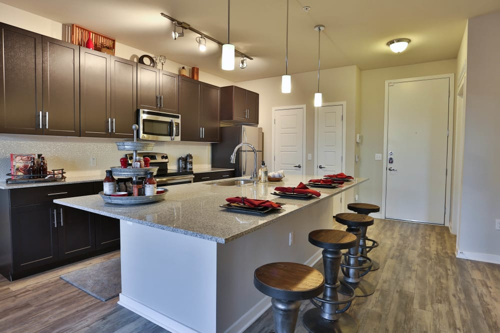 Model apartment's gourmet kitchen with ample cupboard space at Olympus Steelyard in Chandler, Arizona