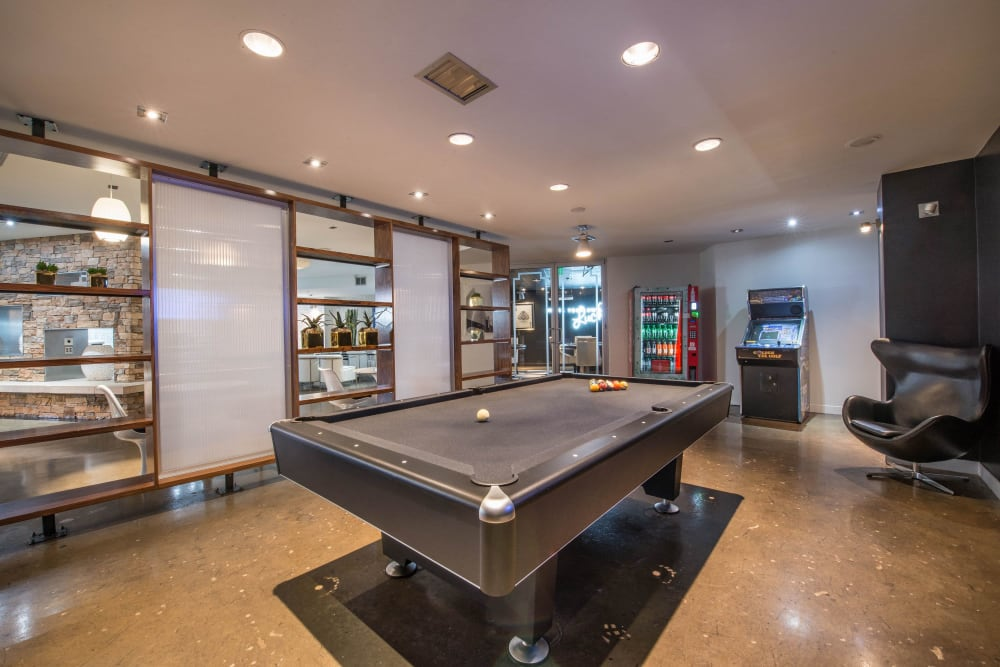 Residents lounge with billiards table at Mosaic Dallas in Dallas, Texas