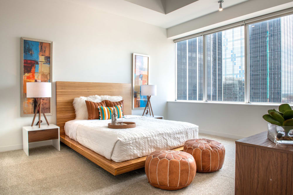 Well-lighted bedroom at Mosaic Dallas in Dallas, Texas