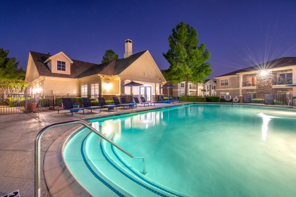 Underwater illumination in the swimming pool at twilight at Olympus Stone Glen in Keller, Texas
