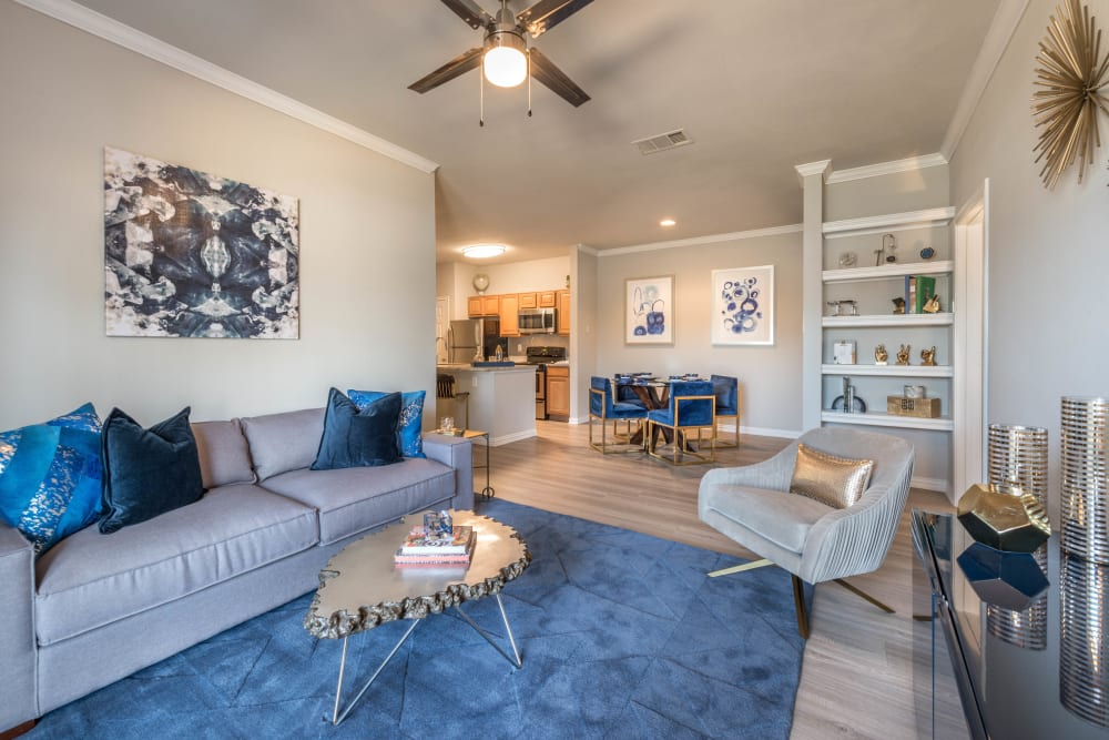 Well-furnished open-concept living area in a model apartment at Olympus Stone Glen in Keller, Texas