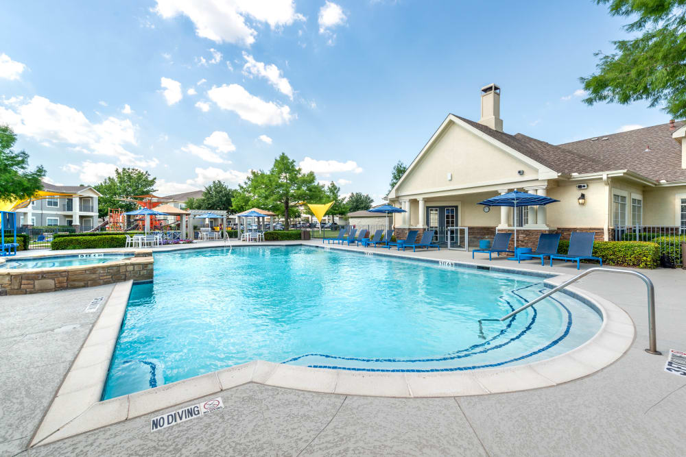 Resort-style swimming pool on a beautiful day at Olympus Stone Glen in Keller, Texas