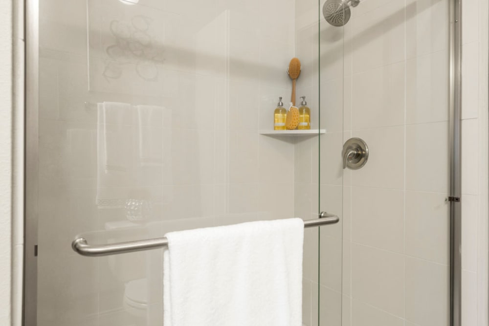 Walk-in shower in apartment at Olympus Grand Crossing in Katy, Texas