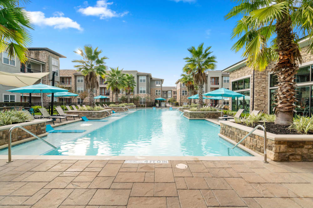 Sparkling pool at Olympus Grand Crossing in Katy, Texas
