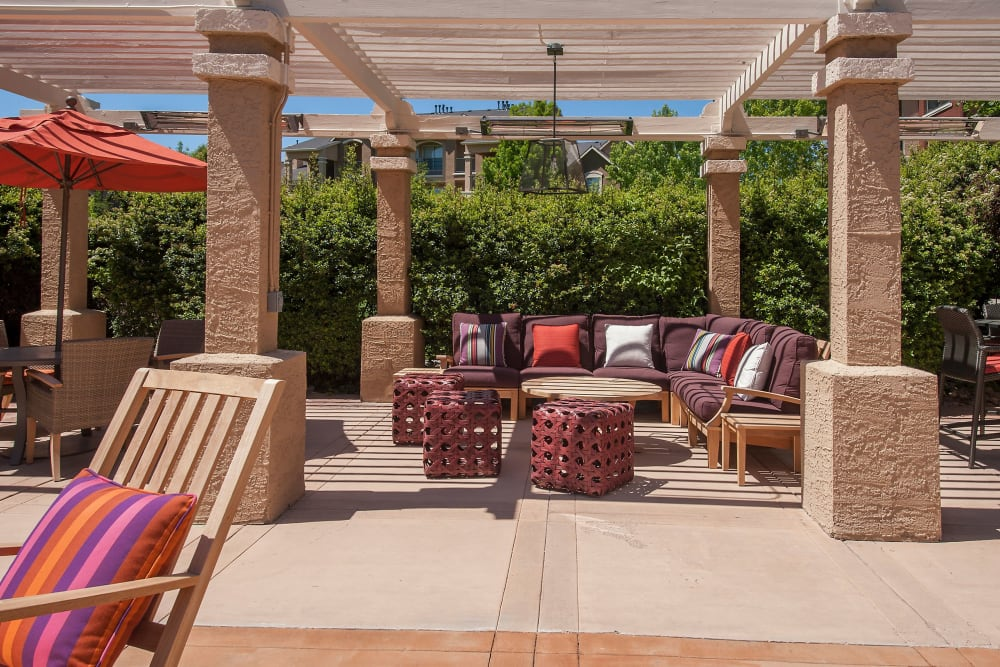 Outdoor seating with tables at The Vintage at South Meadows Condominium Rentals in Reno, Nevada