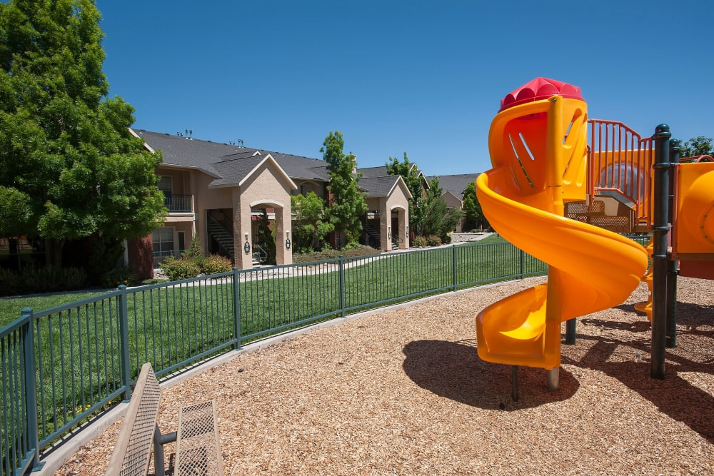 Children's playground with a slide at The Vintage at South Meadows Condominium Rentals in Reno, Nevada
