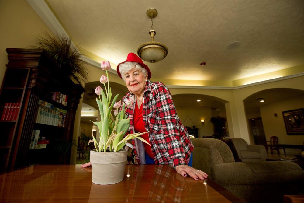 senior resident doing some flower potting