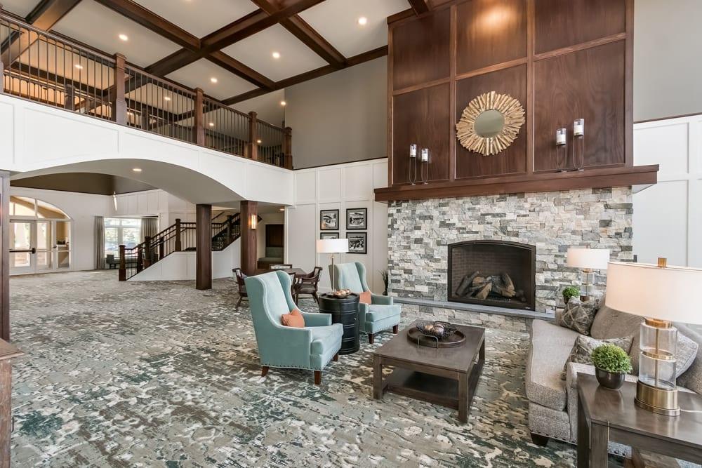 Lobby with fireplace at Applewood Pointe of Eden Prairie in Eden Prairie, Minnesota.