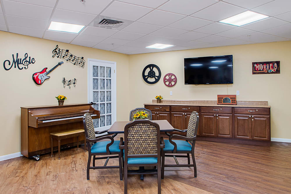 Music room with a piano at Grand Villa of Lakeland in Florida