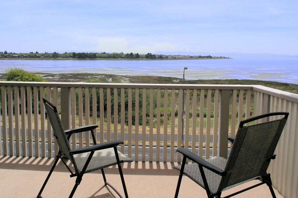 Spacious apartment patio with a view of the beach at Tower Apartment Homes in Alameda, California