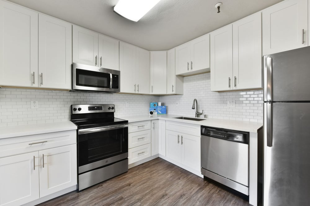 Luxury apartment kitchen with stainless-steel appliances at Tower Apartment Homes in Alameda, California