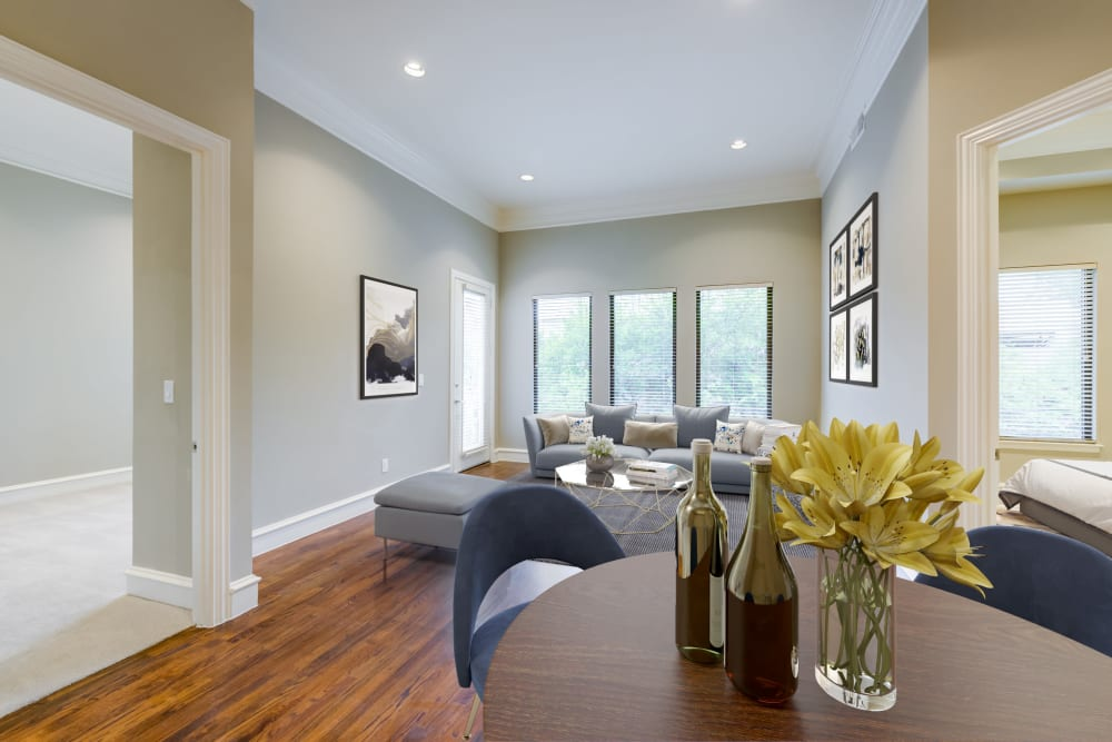 Well lit, spacious living room at Rienzi at Turtle Creek Apartments