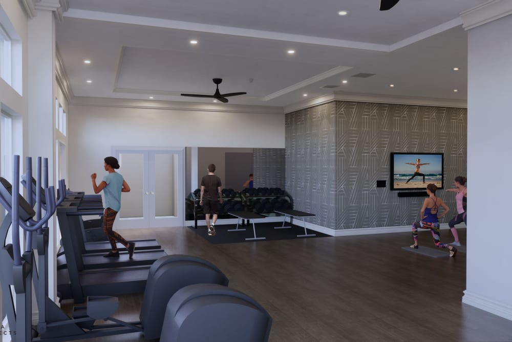 Fitness center with cardio machines at Rienzi at Turtle Creek Apartments