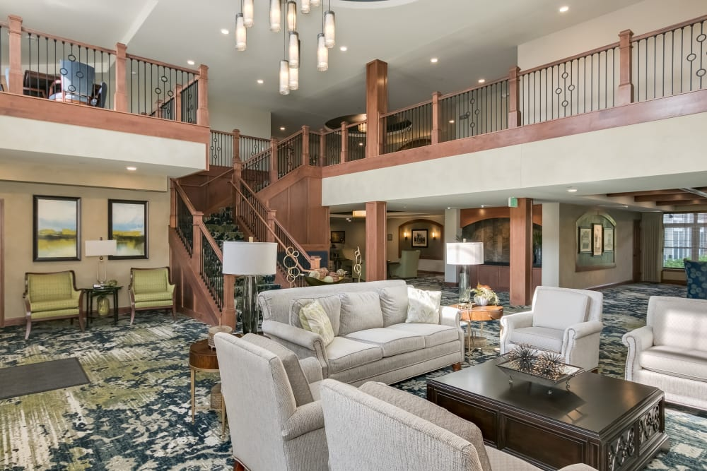 Lobby with a large staircase at Applewood Pointe Roseville at Central Park in Roseville, Minnesota.