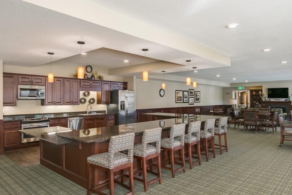 Club room kitchen at Applewood Pointe Roseville at Central Park in Roseville, Minnesota.