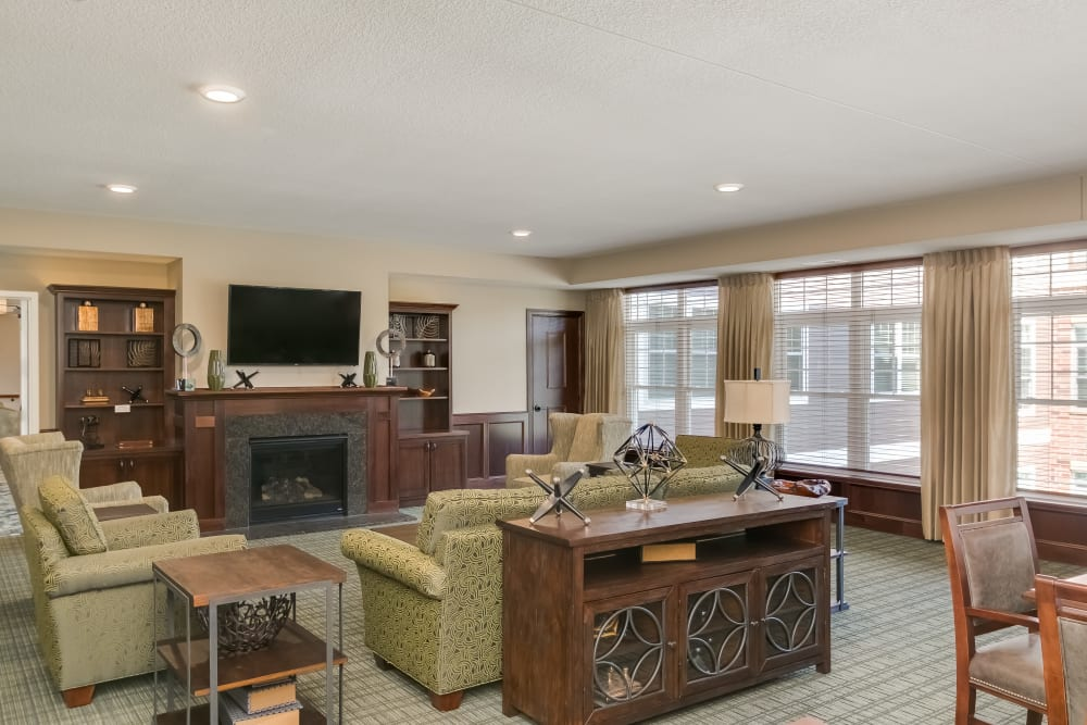 Club room seating area with natural light at Applewood Pointe Roseville at Central Park in Roseville, Minnesota.