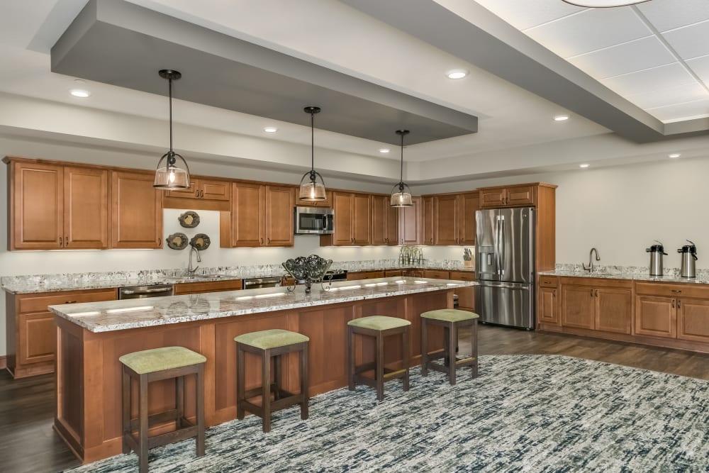 Great room kitchen at Applewood Pointe Roseville at Central Park in Roseville, Minnesota.