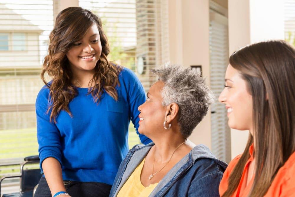 Family members come to visit at Milestone Senior Living Stoughton in Stoughton, Wisconsin.