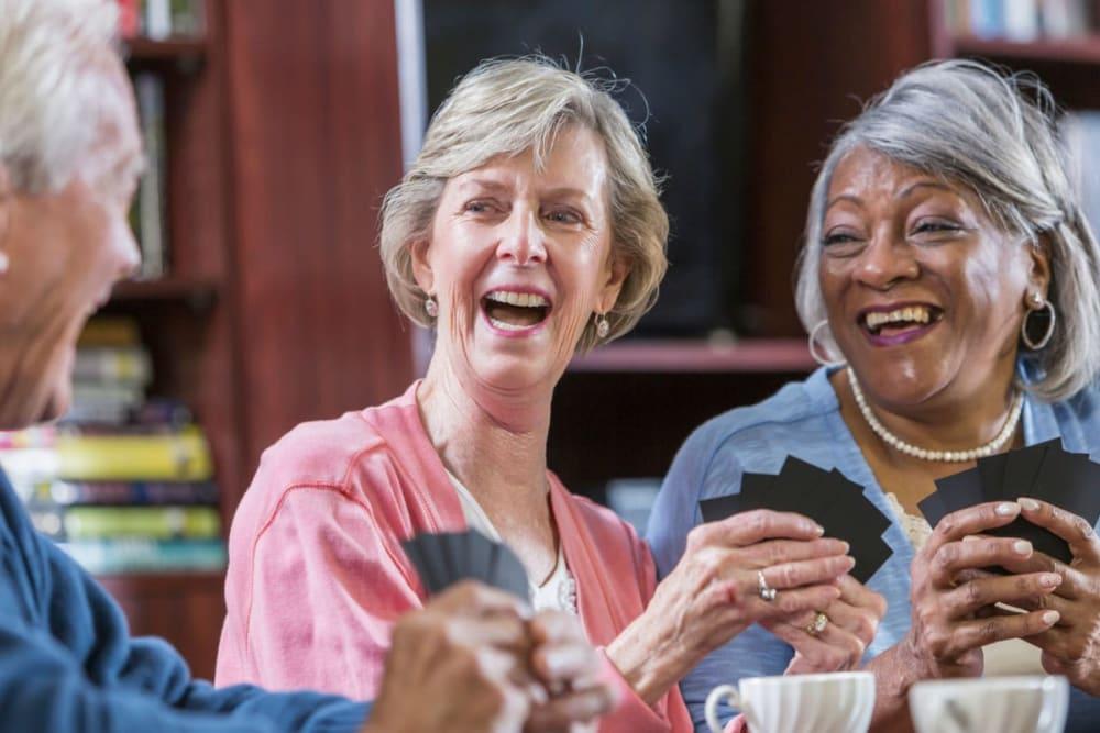 Residents playing a card game at Milestone Senior Living Stoughton in Stoughton, Wisconsin.
