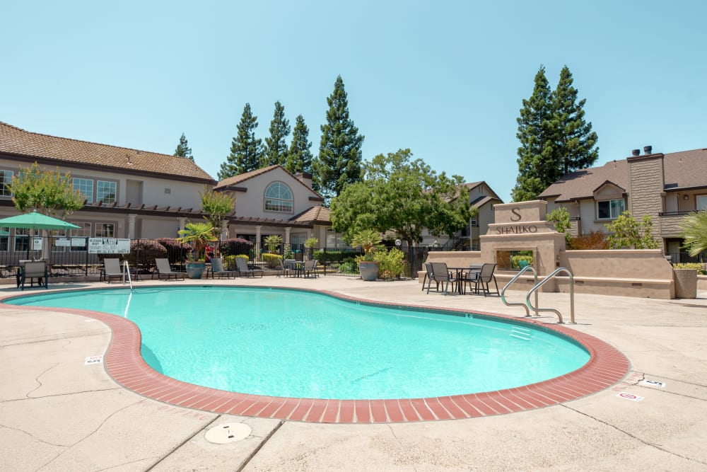 Swimming pool with a large sundeck for summer days at Shaliko in Rocklin, California