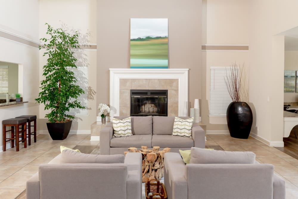 Clubhouse with a fireplace and comfortable couches at Shaliko in Rocklin, California