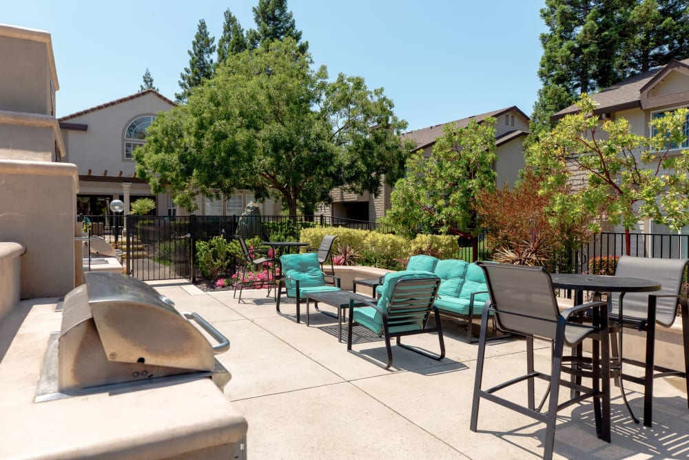 Comfortable outdoor seating next to the pool at Shaliko in Rocklin, California