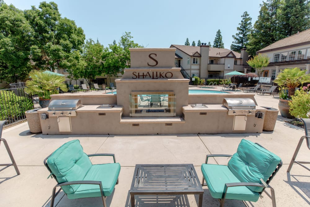Comfortable seating next to an outdoor fireplace and gas-grills at Shaliko in Rocklin, California