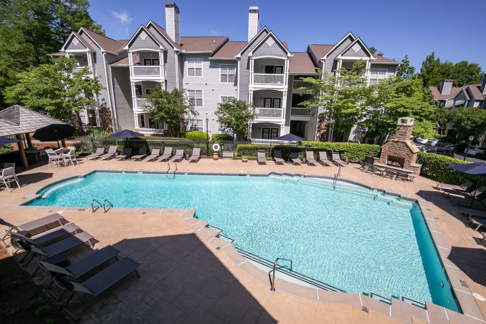 Spacious pool and surrounding patio area at Highland Square in Atlanta, Georgia