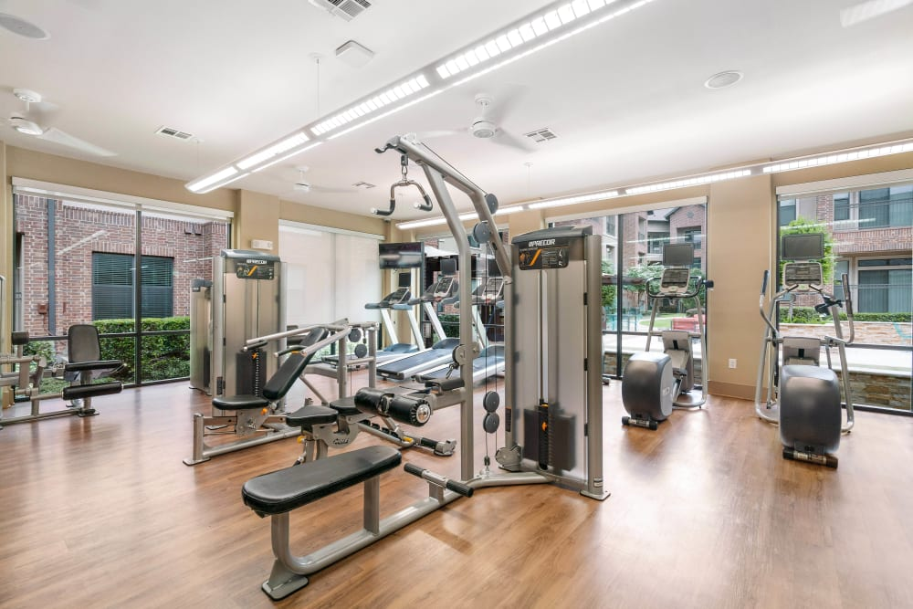 Well-equipped onsite fitness center at Olympus Sierra Pines in The Woodlands, Texas