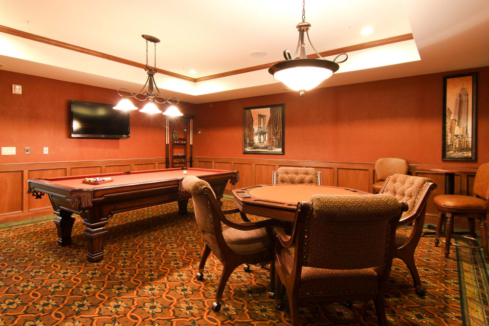 Resident game room with a pool table at Applewood Pointe Roseville at Langton Lake in Roseville, Minnesota.