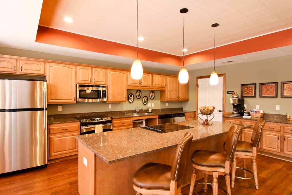 Great room kitchen at Applewood Pointe of Roseville at Langton Lake in Roseville, Minnesota.