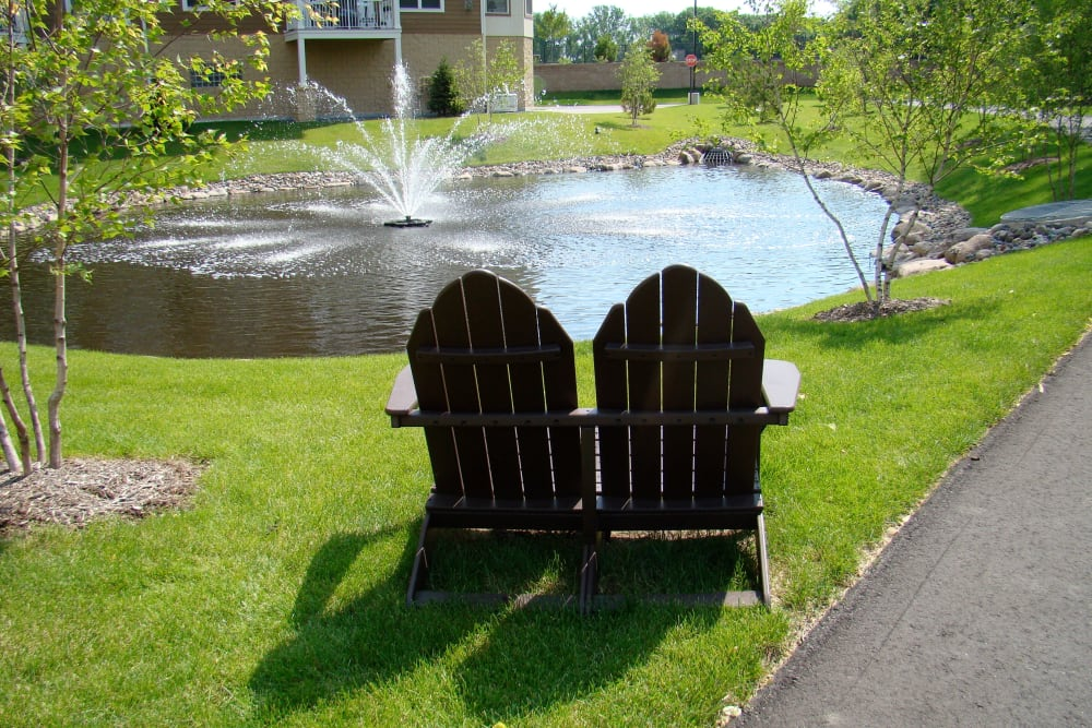 Seats by the pond at Applewood Pointe Roseville at Langton Lake community in Roseville,  Minnesota.