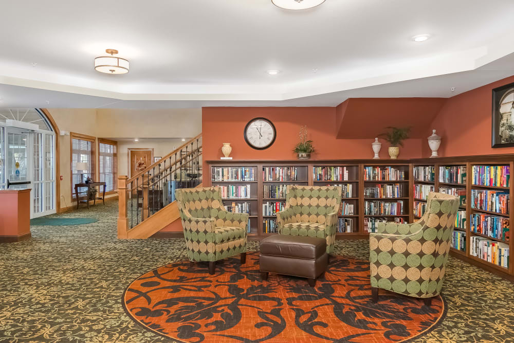 Library with seating area at Applewood Pointe Shoreview in Shoreview, Minnesota.