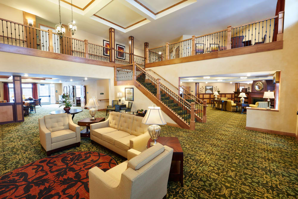 Main lobby with a grand staircase at Applewood Pointe Shoreview in Shoreview, Minnesota.