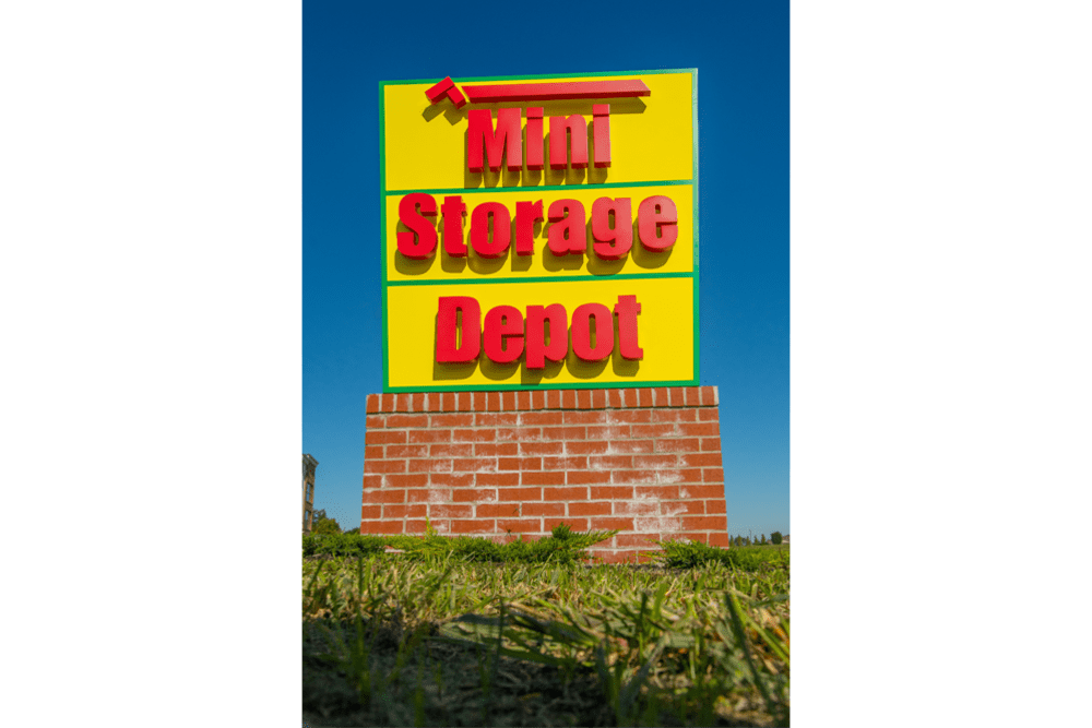 A large sign for Mini Storage Depot in Louisville, Kentucky
