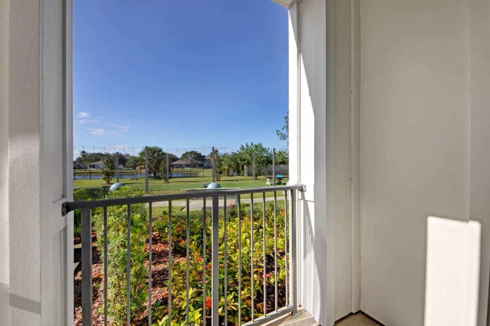 A beautiful view of the landscaping from an apartment balcony at Linden on the GreeneWay in Orlando, Florida