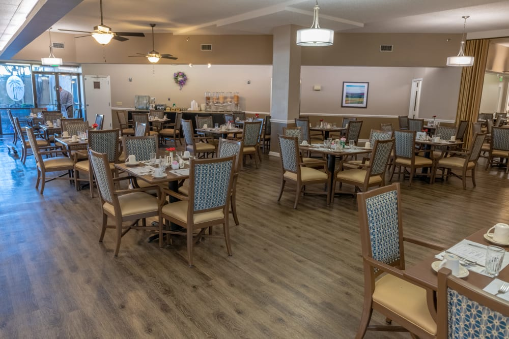 A large dining room at Royal Palm Senior Living in Port Charlotte, Florida