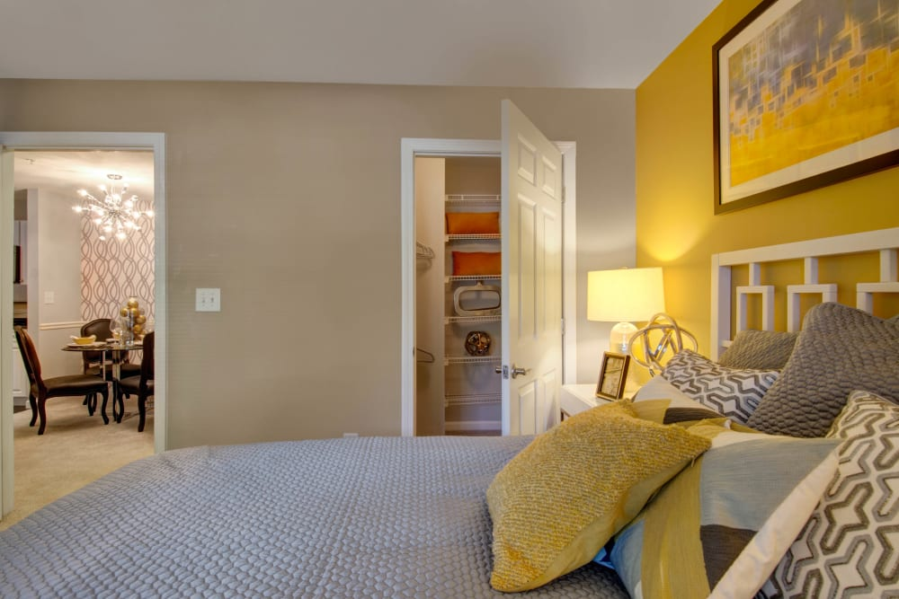 A bedroom with a walk-in closet at Ellington Metro West in Westborough, Massachusetts