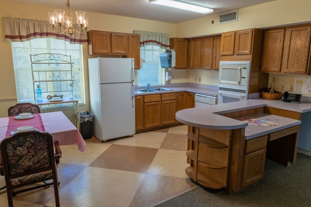 An apartment kitchen at Village Place Senior Living in Port Charlotte, Florida