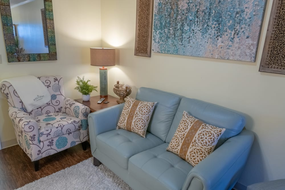 A finished apartment living room at Village Place Senior Living in Port Charlotte, Florida