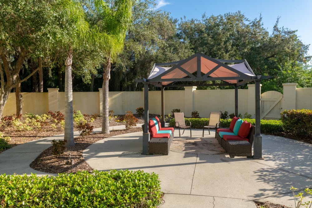 A covered, outdoor seating area at Village Place Senior Living in Port Charlotte, Florida