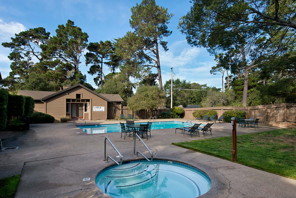 Hot tub next to a grassy lawn at Seventeen Mile Drive Village Apartment Homes in Pacific Grove, California
