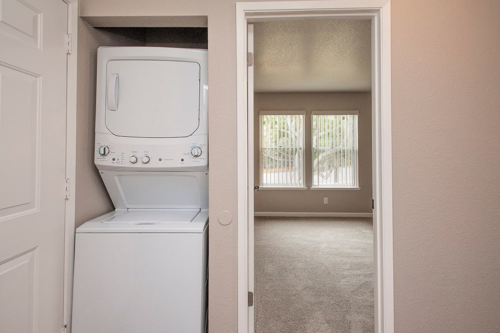 Stacked washer and dryer at Seventeen Mile Drive Village Apartment Homes in Pacific Grove, California