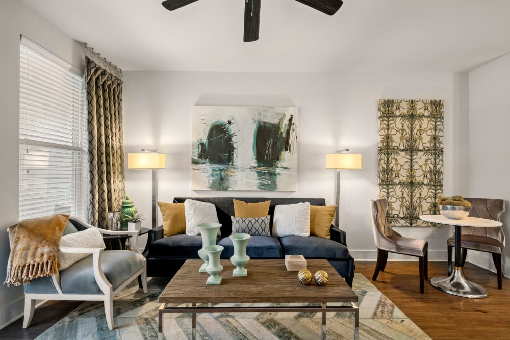 Well-furnished living space in a model home at Olympus Grand Crossing in Katy, Texas
