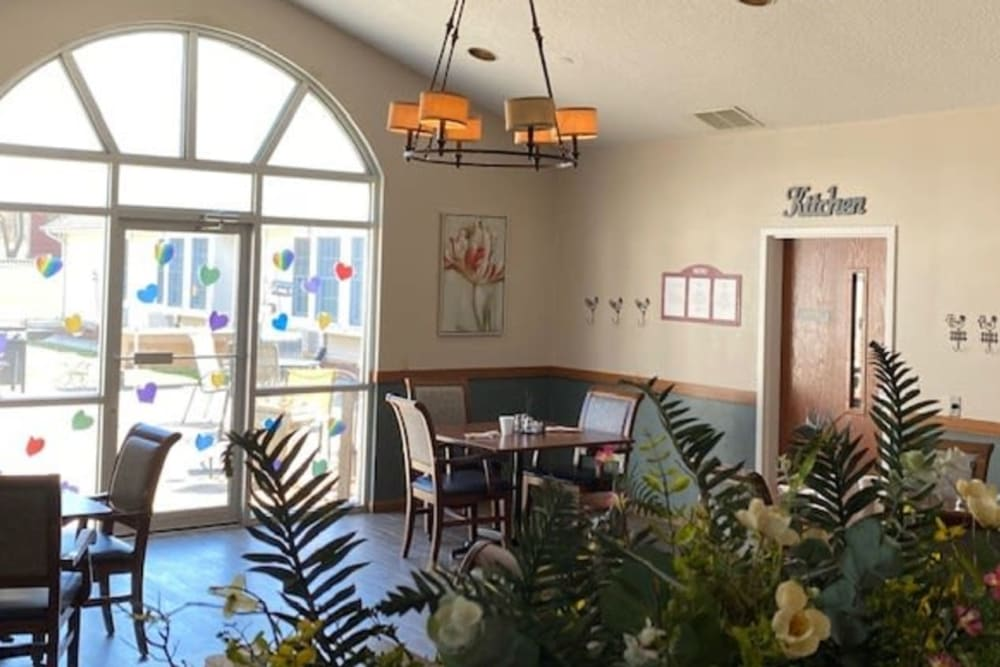 Resident dining area with large windows at Liberty Court in Dixon, Illinois.
