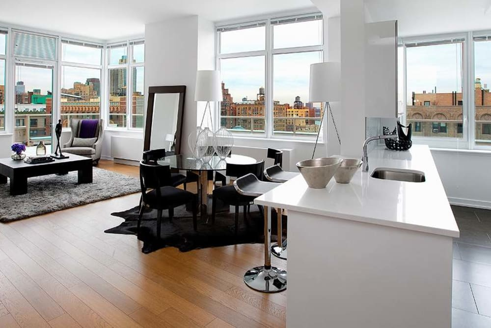 Open-concept floor plan with large windows at The Larstrand in New York, New York